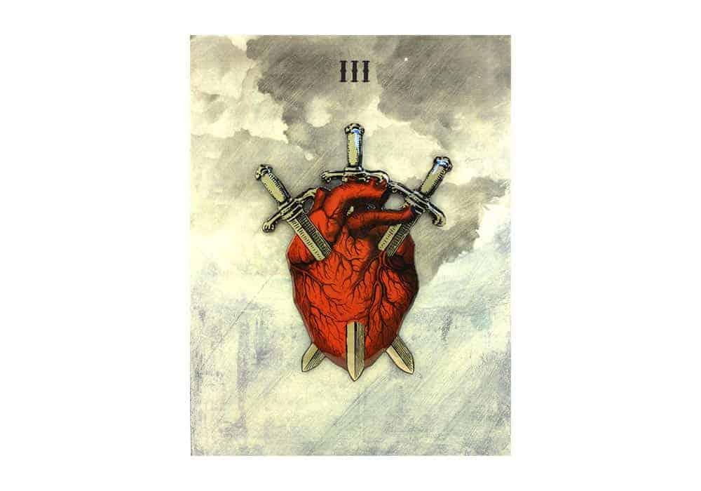 Tarot i ljubav – značenje pojedine karte (Trojka mačeva)